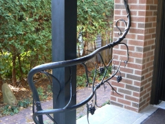 hand-forged-wrought-iron-tree-railing-1